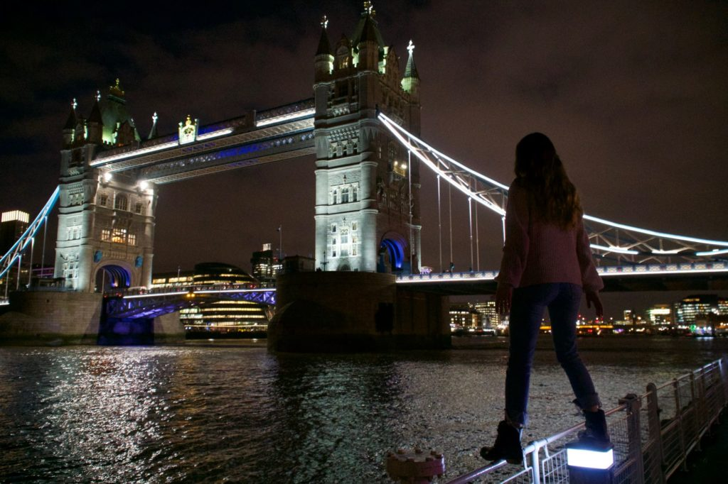 girl standing beside tower bridge in london