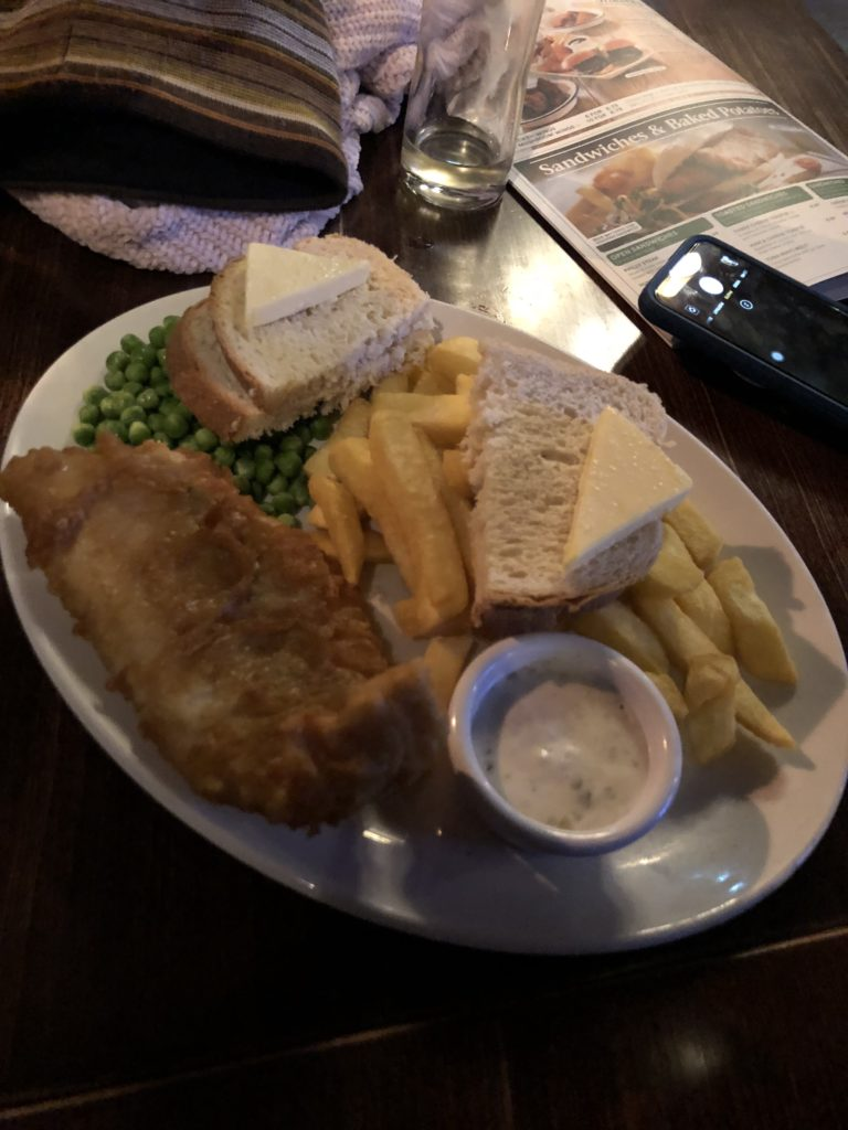 a plate of fish and chips from prospect of whitby london pub