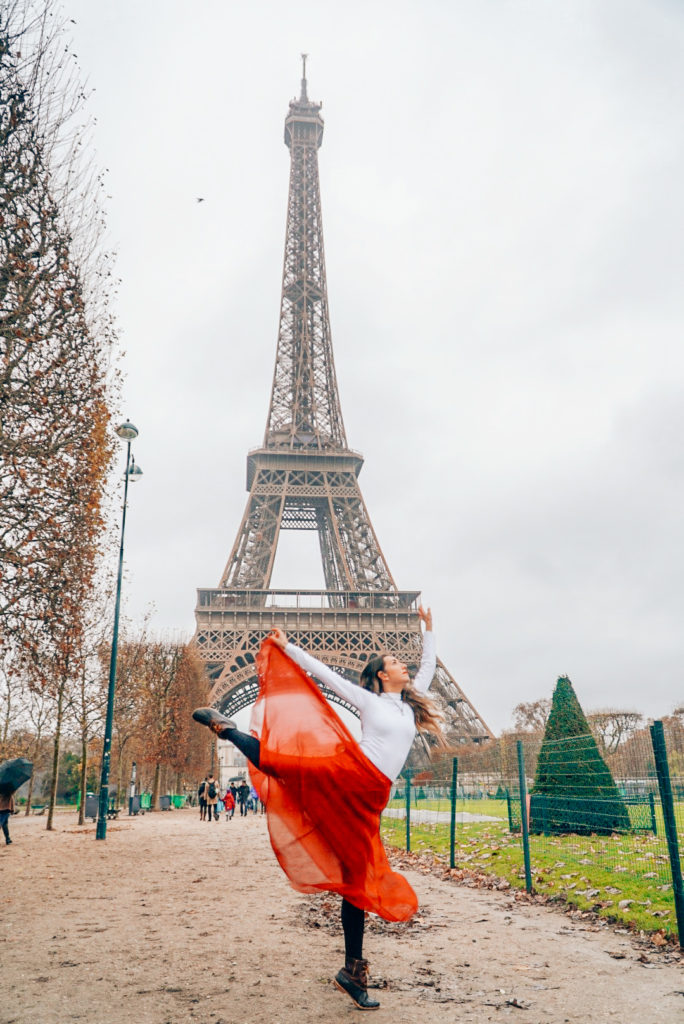 girl in front of eiffel tower in paris