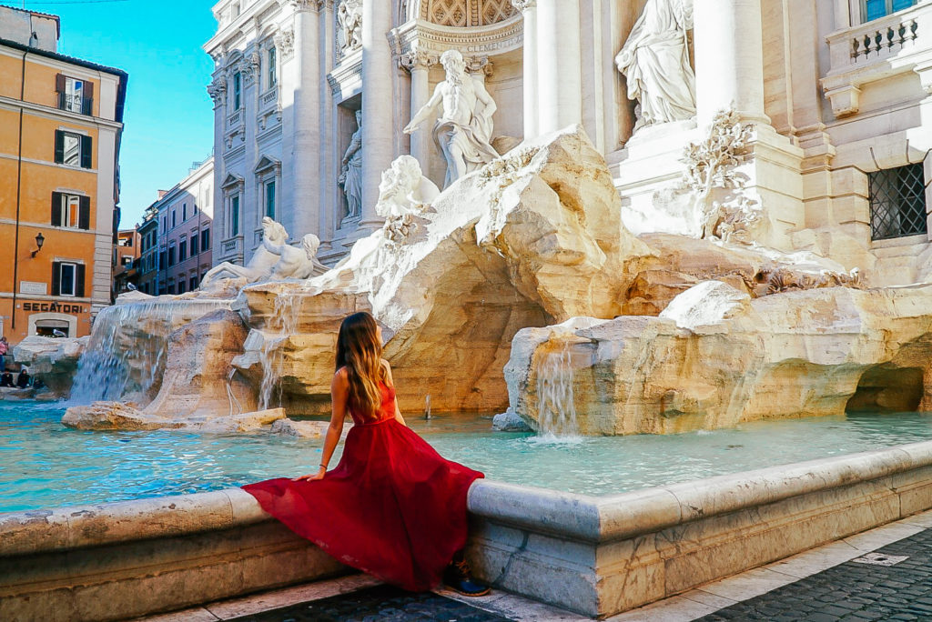 girl in front of the trevi fountain rome